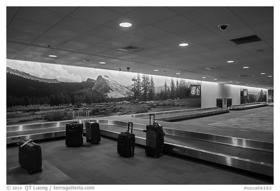 Baggage claim area and Yosemite murals, Fresno Yosemite Airport. California, USA (black and white)
