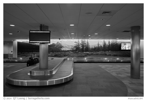Baggage claim area and Tuolumne Meadows mural, Fresno Yosemite Airport. California, USA (black and white)