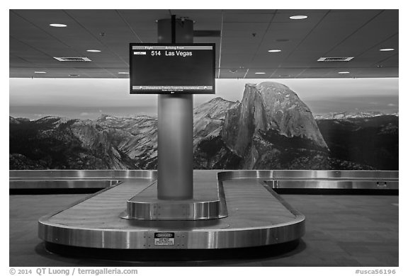 Baggage claim area and Half-Dome mural, Fresno Yosemite Airport. California, USA (black and white)