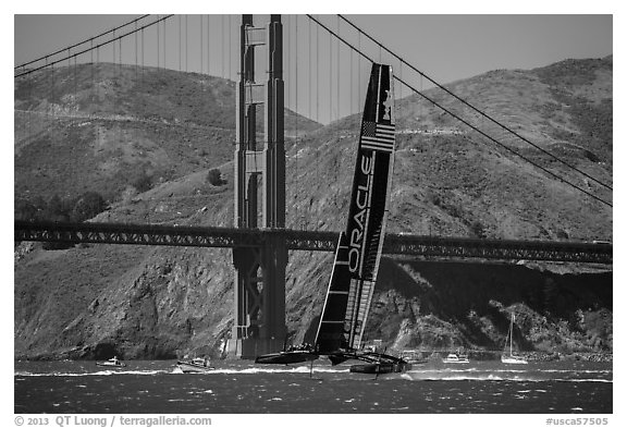 Oracle Team USA defender America's cup boat and Golden Gate Bridge. San Francisco, California, USA (black and white)