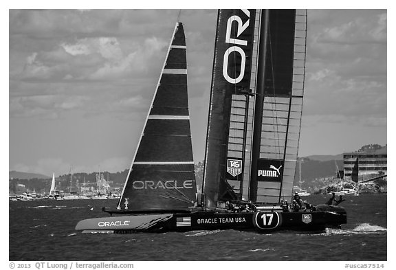 Crew in action on USA boat during victorious final race. San Francisco, California, USA (black and white)