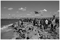 Spectators cheering during America's Cup decisive race. San Francisco, California, USA (black and white)