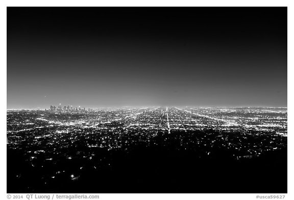 Lights of street grid and downtown at night from above. Los Angeles, California, USA (black and white)