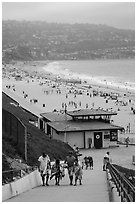 Beachgoers walking up from beach, Redondo Beach. Los Angeles, California, USA ( black and white)