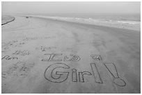 Words written in sand on beach. Newport Beach, Orange County, California, USA ( black and white)
