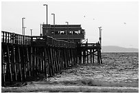 Newport Pier in late afternoon. Newport Beach, Orange County, California, USA ( black and white)