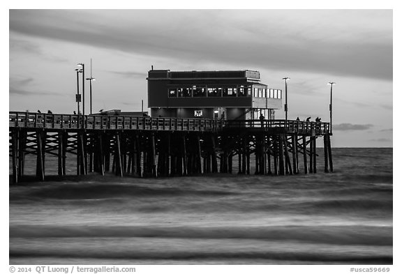 Newport Pier and restaurant at sunset. Newport Beach, Orange County, California, USA (black and white)