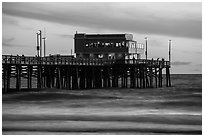 Newport Pier and restaurant at sunset. Newport Beach, Orange County, California, USA ( black and white)
