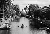 Woman rowing in canal. Venice, Los Angeles, California, USA ( black and white)