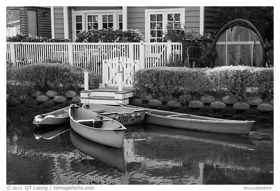 Rowboats in front of house, Venice Canal Historic District. Venice, Los Angeles, California, USA (black and white)