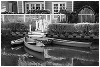 Rowboats in front of house, Venice Canal Historic District. Venice, Los Angeles, California, USA ( black and white)