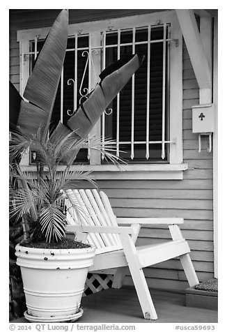Matching white garden chair, flower pots, and window on porch. Venice, Los Angeles, California, USA (black and white)