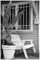 Matching white garden chair, flower pots, and window on porch. Venice, Los Angeles, California, USA ( black and white)