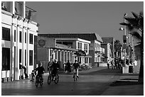Riding bicycles on beachfront promenade, Hermosa Beach. Los Angeles, California, USA ( black and white)