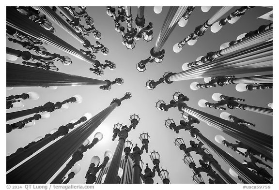 Looking up Chris Burden art installation of street lamps at LACMA. Los Angeles, California, USA (black and white)