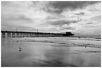 Newport Pier and clouds. Newport Beach, Orange County, California, USA ( black and white)