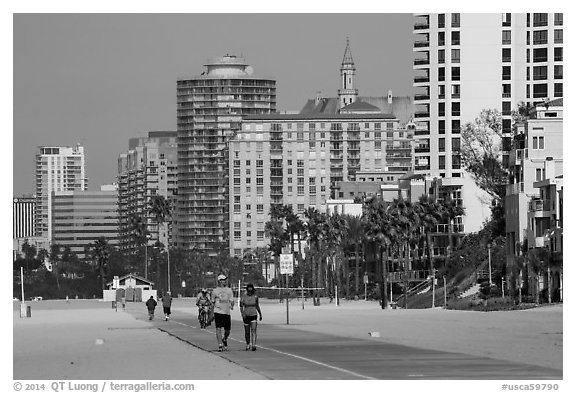 People exercising on beach promenade. Long Beach, Los Angeles, California, USA (black and white)