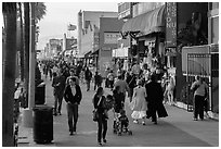People stroll on Ocean Front Walk. Venice, Los Angeles, California, USA ( black and white)