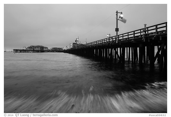 Pier and wave at dawn. Santa Barbara, California, USA (black and white)