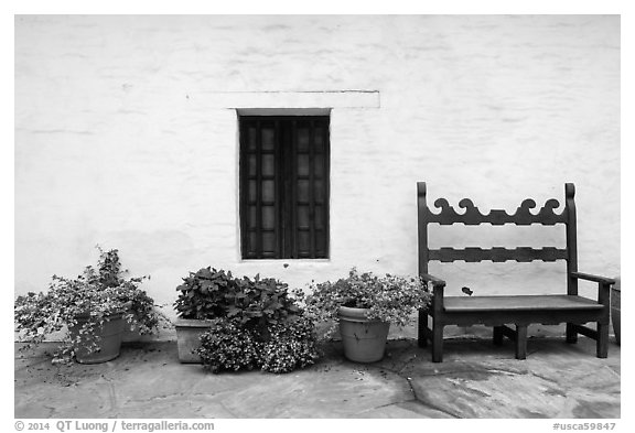 Potted plants, bench and wall, Historic Paseo. Santa Barbara, California, USA (black and white)
