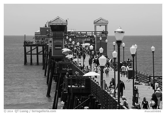 Lamps and pier, Oceanside. California, USA (black and white)