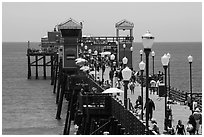 Lamps and pier, Oceanside. California, USA ( black and white)
