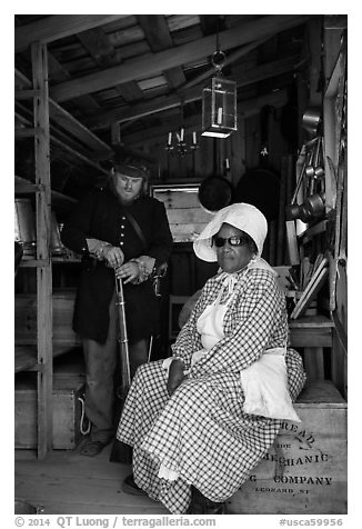 Elderly couple in period costume, Fort Tejon. California, USA (black and white)