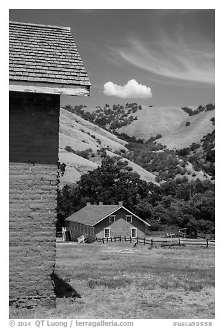 Barracks and hills, Fort Tejon state historic park. California, USA (black and white)