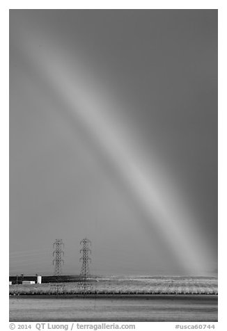 Rainbow above agricultural lands. California, USA (black and white)