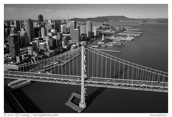 Aerial view of Bay Bridge, downtown, and piers. San Francisco, California, USA (black and white)