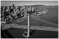 Aerial view of Bay Bridge, downtown, and piers. San Francisco, California, USA ( black and white)