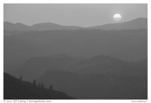Setting sun and mountain ridges, Stanislaus National Forest. California, USA (black and white)
