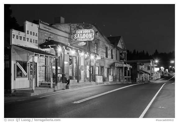 Iron Door Saloon and Groveland main street at night. California, USA (black and white)