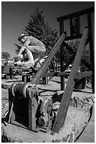 Mining equipment and statue commemorating gold rush, Auburn. California, USA ( black and white)