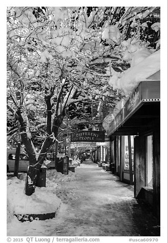 Sidewalk with fresh snow at night, Truckee. California, USA (black and white)