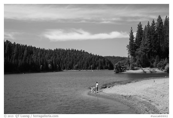 Family on shore of Jenkinson Lake, Pollock Pines. California, USA (black and white)