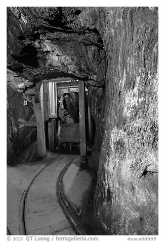 Gallery with tracks and ore car, Gold Bug Mine, Placerville. California, USA (black and white)