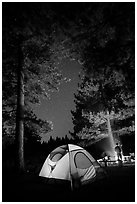 Tent and campfire at night,  Prosser Ranch Group Campground, Tahoe National Forest. California, USA ( black and white)