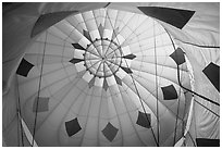 Looking up inside yellow hot air balloon. California, USA ( black and white)