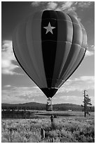 Hot air balloon low next to Prosser Reservoir, Tahoe National Forest. California, USA ( black and white)