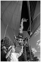 Pilot releases hot air into balloon, Tahoe National Forest. California, USA ( black and white)