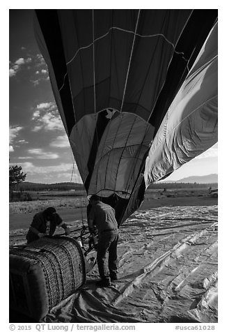 Crew pulling down hot air ballon, Tahoe National Forest. California, USA (black and white)