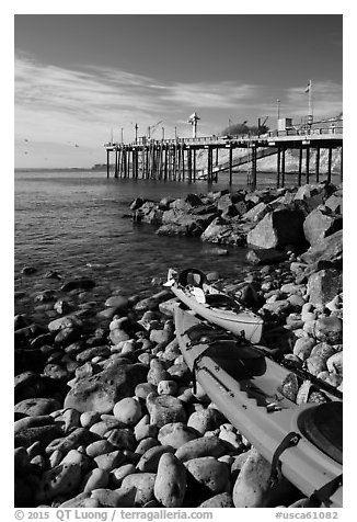 Sea Kayaks used for abalone diving and Wharf. California, USA (black and white)