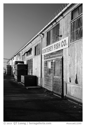 Monterey Fish Company buildings on wharf. Monterey, California, USA (black and white)