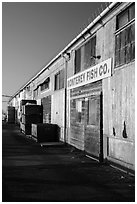 Monterey Fish Company buildings on wharf. Monterey, California, USA ( black and white)