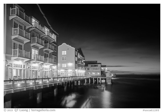 Waterfront hotels at night. Monterey, California, USA (black and white)