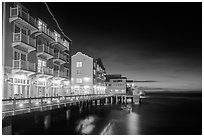 Waterfront hotels at night. Monterey, California, USA ( black and white)