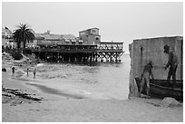 Beach near Cannery Row on cloudy day. Monterey, California, USA ( black and white)
