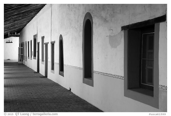 Brightly colored windows, inside arcade, Mission San Miguel. California, USA (black and white)