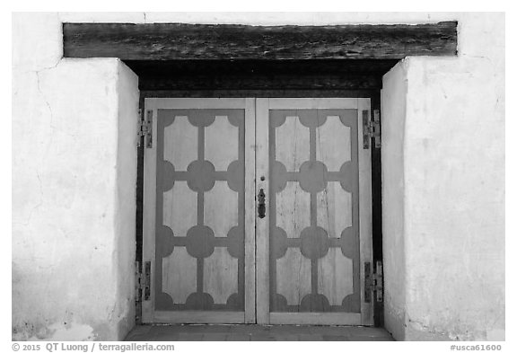 Decorated wooden door, Mission San Miguel. California, USA (black and white)